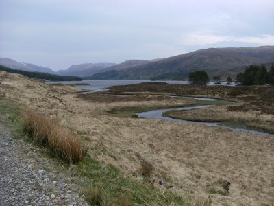 Loch Ossian with the bulk of Ben Alder in the distance